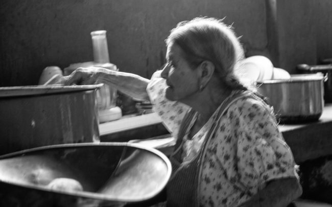 Senior woman attending restaurant kitchen - Antigua, Guatemala