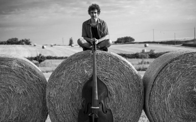 Jorge da Rocha musician outdoors portrait with Double Bass-black and white picture