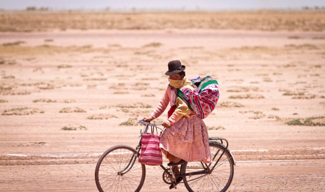 Bolivian woman on a bicycle, Bolivia