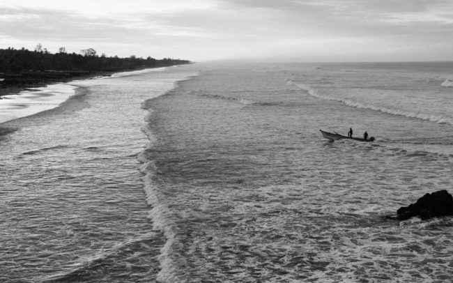 Fishermen arriving at the beach, El Salvador