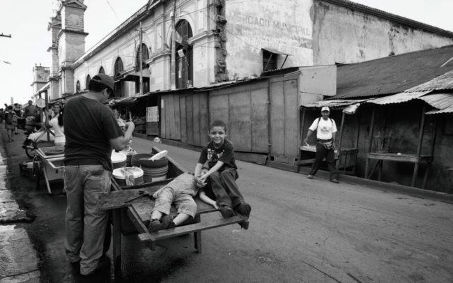Children and father in street market, Granada, Nicaragua