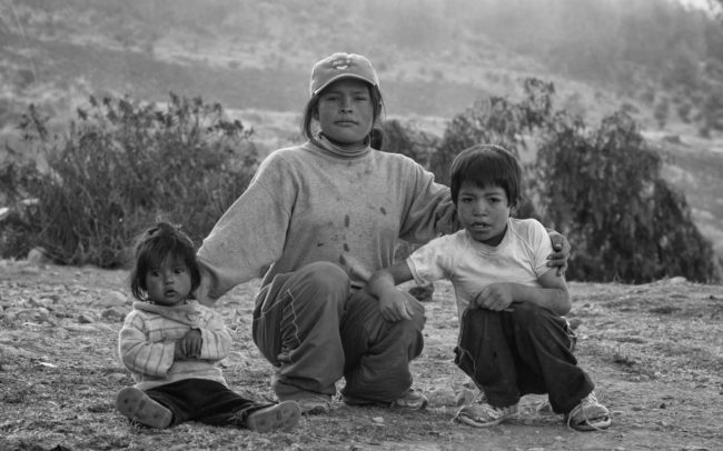 Mother and children in the mountains of Ayacucho, Peru
